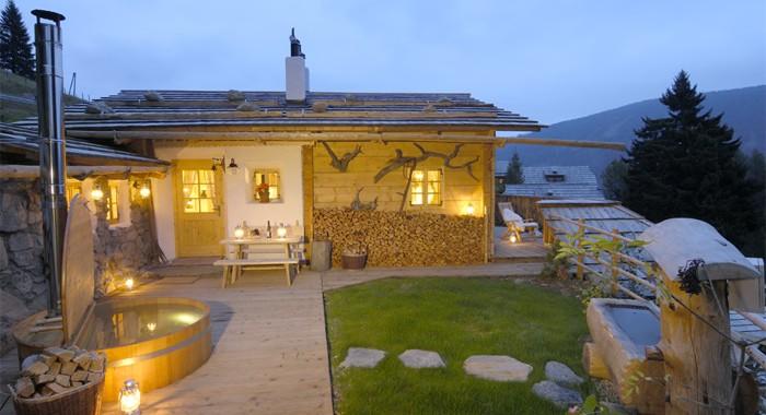 Almdorf seinerzeit almdorf der luxusklasse berge exclusiv for Chalet haus bauen
